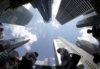 exclusive-singapore-cautions-wealth-managers-on-aggressively-courting-hk-business