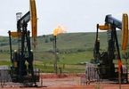 us-oil-output-surge-reminiscent-of-run-up-to-2014-crash-miami-herald
