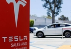 deal-hungry-investment-bankers-walk-tesla-tightrope
